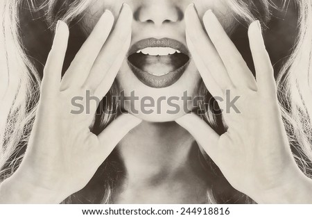 Attractive young sexy woman lipstick lipgloss lips is announcing, telling a secret, shouting or yelling sepia retro vintage old - stock photo