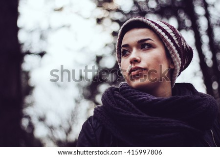 Attractive young short-haired brunette girl posing in forest  - stock photo