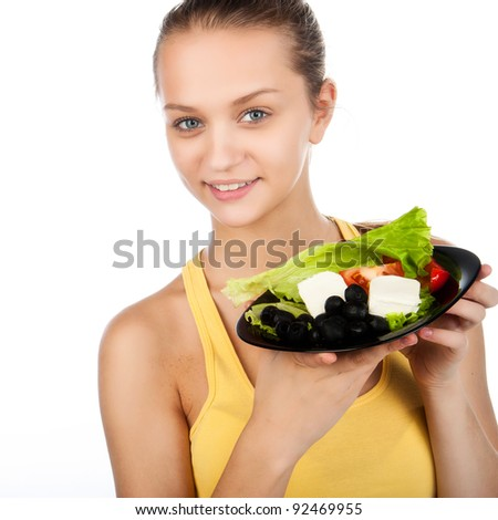 attractive young smiled woman with plate of salad, caucasian shiny girl eating vegetable salad, pretty woman holding the plate of greek salad, healthy vegetarian salad,isolated on white background