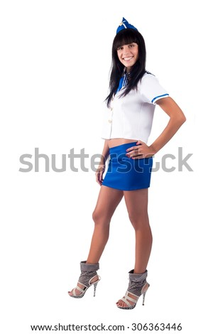 Attractive young stewardess smiles. Isolated over white background