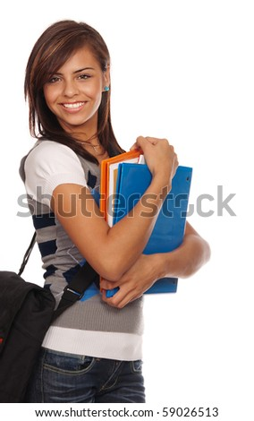 Attractive young student going back to school college smiling and holding books. - stock photo