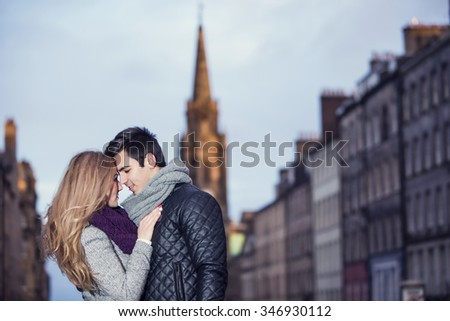 Attractive young stylish couple in love outdoors  - stock photo