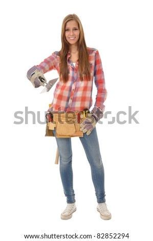 Attractive young trainees with long hair holding a trowel - stock photo