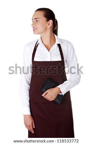 Attractive young waitress with notebook in hand, isolated on a white background - stock photo