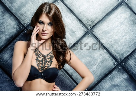Attractive young woman alluring in sexual lingerie and jewels. Studio shot. Beauty, fashion. Jewellery. - stock photo