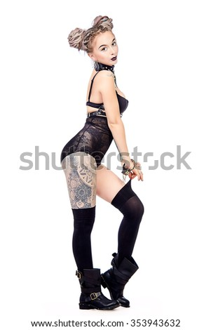 Attractive young woman alluring in sexy lingerie and handcuffs. BDSM. Full length portrait. Isolated over white. - stock photo