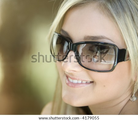 Attractive Young Woman Blond Haired Woman wearing sunglasses