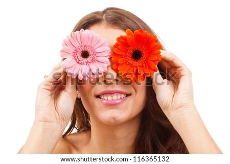 Attractive young woman covering her eyes with flowers - stock photo