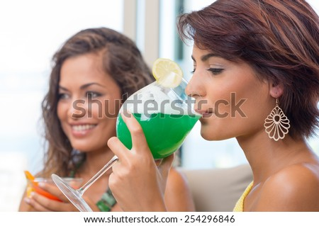 Attractive Young Woman Drinking At Happy Hour With A Friend - stock photo