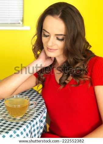 Attractive Young Woman Drinking Green Tea