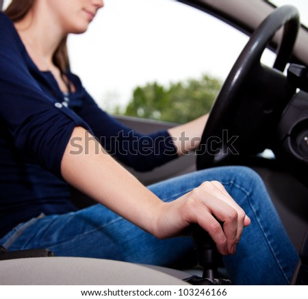 Attractive young woman driving car. - stock photo