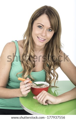 Attractive Young Woman Eating Breakfast Cereals