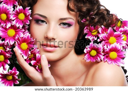 Attractive young woman face with flowers - stock photo