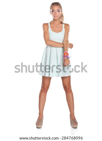 Attractive young woman full length portrait isolated on white  - stock photo