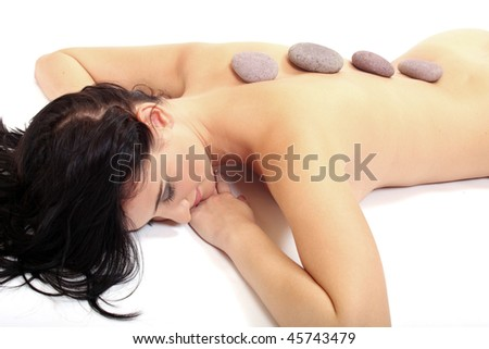Attractive young woman getting spa treatment on white background. Studio shot.