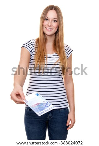 Attractive young woman hands out twenty euro. All on white background.