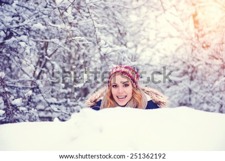 Attractive young woman having fun outside in snow - stock photo