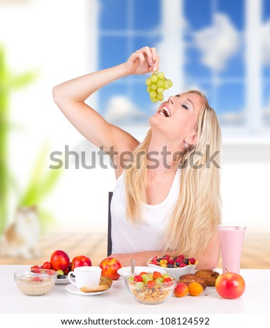 Attractive young woman having healthy breakfast - stock photo