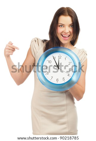Attractive young woman holding a big clock, over white background