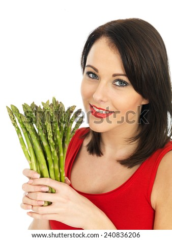 Attractive Young Woman Holding Fresh Asparagus - stock photo
