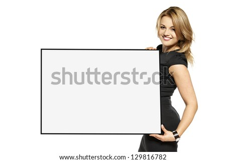Attractive young woman holding up a poster. Isolated on white background. - stock photo