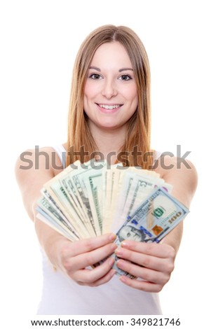 Attractive young woman holding us dollar notes. All on white background.
