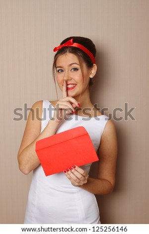 Attractive young woman holds a red mail