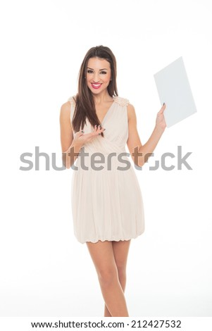 Attractive young woman holds an empty white board for your message - stock photo