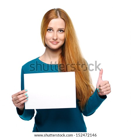 Attractive young woman in a blue shirt. Holds a poster and showing thumbs up. Isolated on white background - stock photo