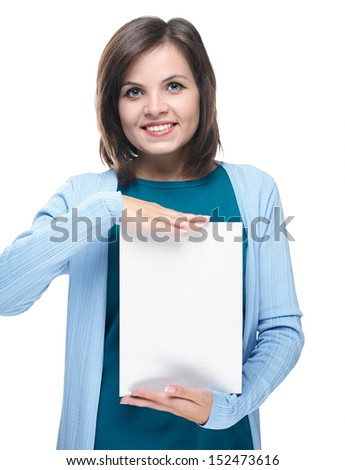 Attractive young woman in a blue shirt. Holds a poster. Isolated on white background - stock photo