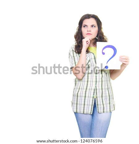 Attractive young woman in a checkered shirt holding a poster with a big question mark. Looks into the upper-right corner. Isolated on white background - stock photo