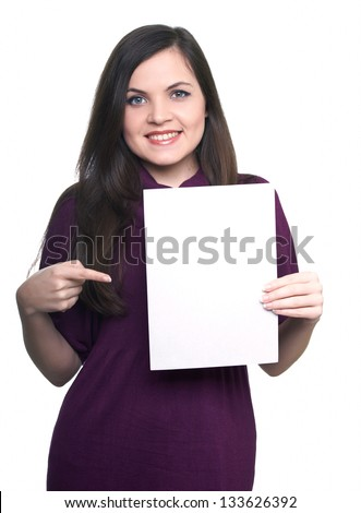 Attractive young woman in a dress. Woman holds a poster and points to him. On  a white background - stock photo