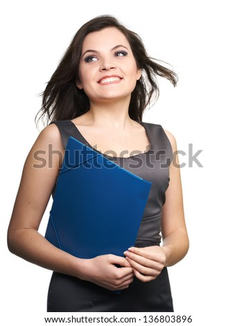 Attractive young woman in a gray business dress. Woman holds a blue folder and looking to the right. Isolated on white background