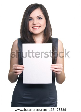 Attractive young woman in a gray business dress. Woman holds a poster. On a white background