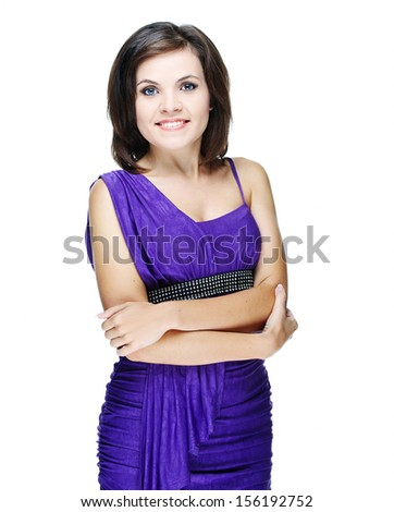 Attractive young woman in a lilac dress. Standing with folded hands. Isolated on white background