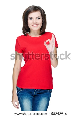 Attractive young woman in a red shirt. Shows sign okay. Isolated on white background
