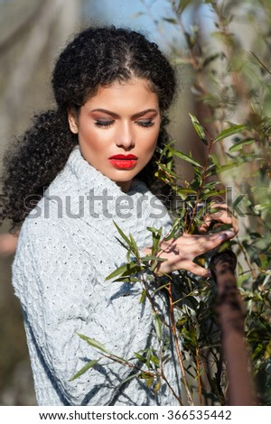 Attractive young woman in autumn outdoor - stock photo