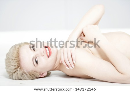 Attractive young woman in beauty style pose with blonde hair.