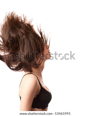 Attractive young woman in bra flipping her hair