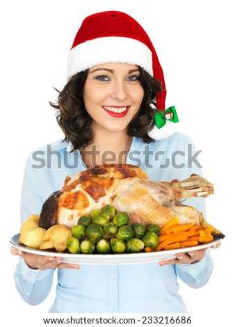 Attractive Young Woman in Christmas Santa Hat Holding Roast Turkey and Vegetables - stock photo