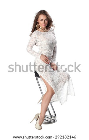 Attractive young woman in classy white dress over white background - stock photo