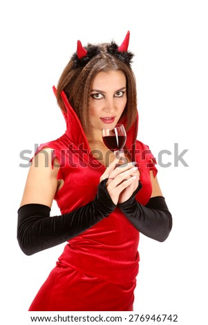 Attractive Young Woman in Halloween Costume of Devil with Glass of Red Wine