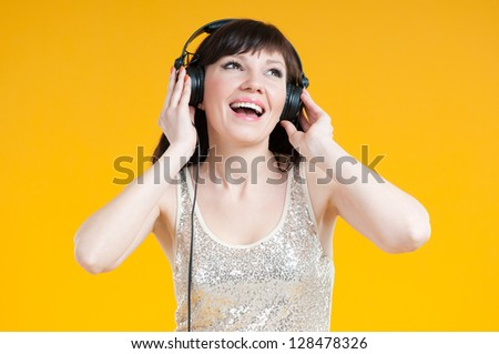 Attractive young woman in headphones enjoying the music - stock photo