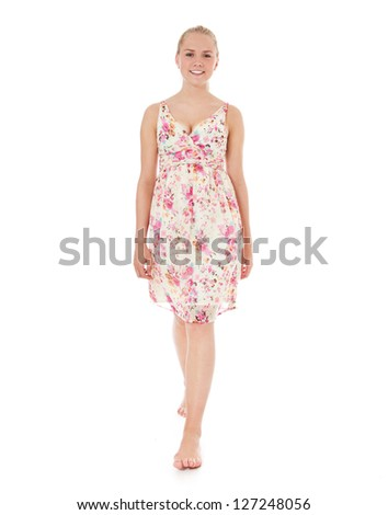 Attractive young woman in light summer dress. All on white background. - stock photo