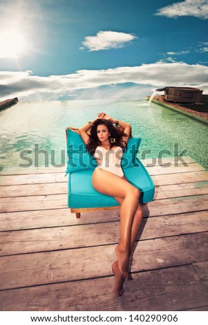 attractive young woman in swimwear enjoy by the pool summer day shot, retro colors - stock photo
