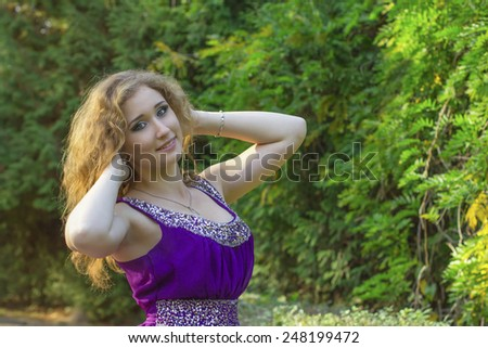 attractive young woman in the park - stock photo