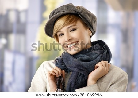 Attractive young woman in winter clothes, smiling. - stock photo