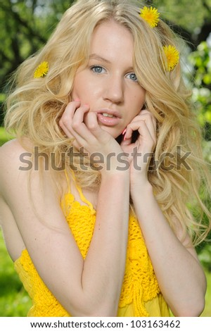Attractive young woman in yellow dress
