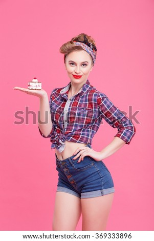 Attractive young woman is presenting sweet food - stock photo