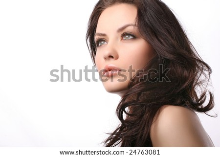 attractive young woman isolated on white looking away from camera - stock photo
